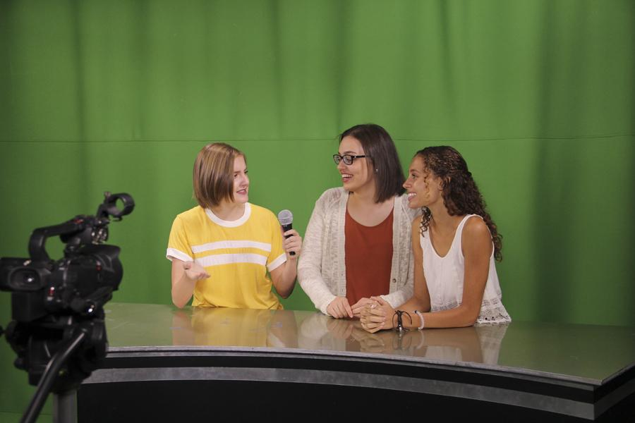 Juniors Rylee Hanson, Ayla Orso, and Gabby Washburn are recording live in front of the camera for Perry Podcast at Perry High School in room F305.