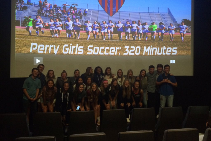 The PS4 and Girl's Soccer teams at the premier of