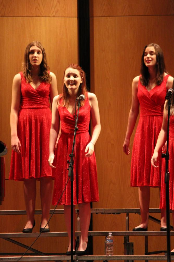 Lily Brower (center) singing at her performance at the Heritage festival on March 31.