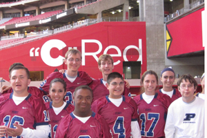 The Unified Sports team poses for a picture after their game at the University of Phoenix Stadium (Arizona Cardinals home). The team played against Chandler during halftime of the Division-1 football championship game.