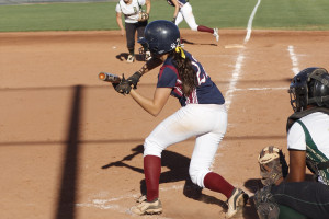 Laynee Gomez bunts earlier this month against Basha High School. The Pumas are primed for their first round playoff game at Corona del Sol Saturday, April 27.