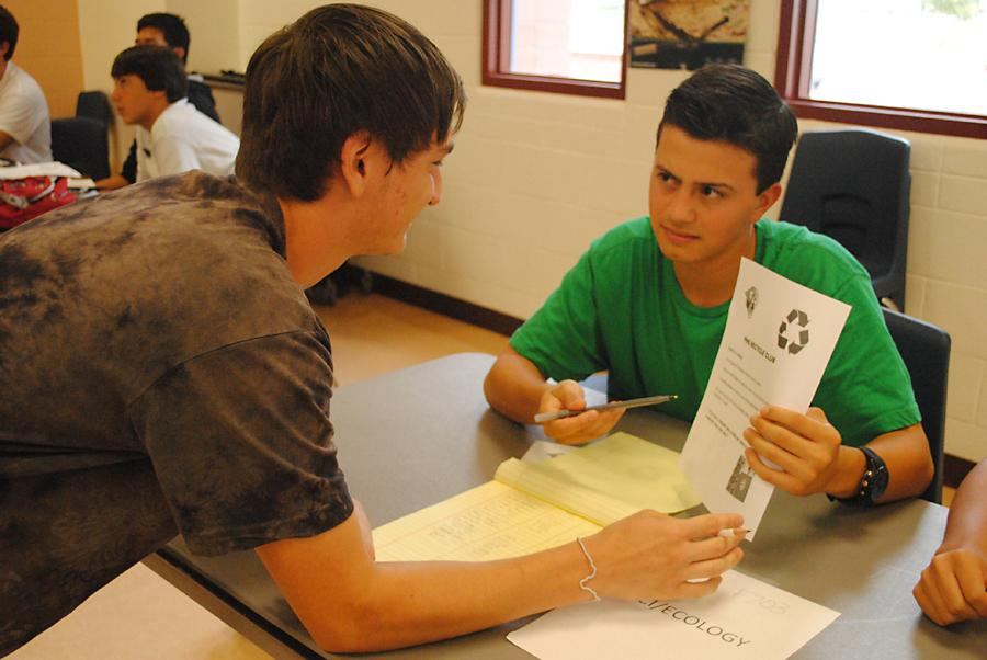 On Tuesday afternoon during B  lunch, Tim Parra, 12, inducts his fellow classmate Keon Fakhimi, 12, into the Ecology club during Club Rush at Perry High School. Photo by Savannah Renaud.