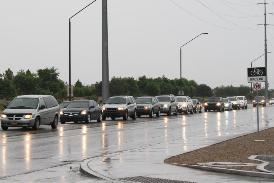 Freshman parents line up down Queen Creek road congesting the surrounding area. Upperclassmen who drive to school are immensely aggravated by the blockage the parents cause.