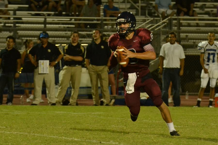 Junior quarterback Austin Nightengale drops back to pass against Sandra Day O'Connor.