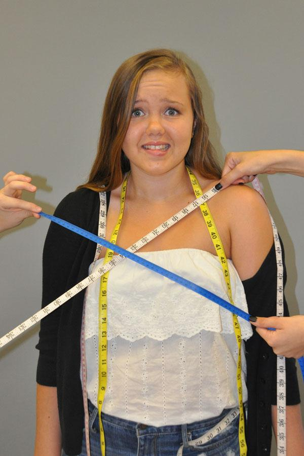 Derss code prohibits students from wearing revealing attire, including tank tops and strapless outfits. Dress code has often been a topic of controversy for students and teachers alike. [Pictured in photo illustration is sophomore Kindra Herre.]