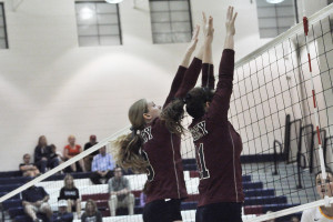 (From left) Abbie McDonald and Ashley Greene attempt to block a shot.