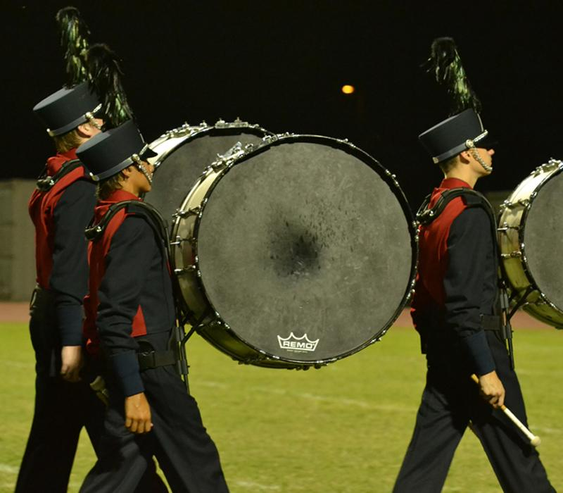 Marching band pumps up the crowd at a past football game by performing this season's show.