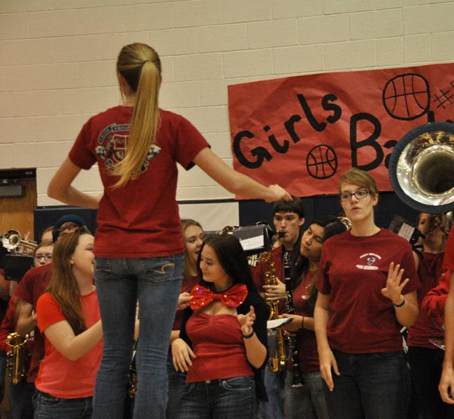 Band plays the fight song as students leave first assembly.