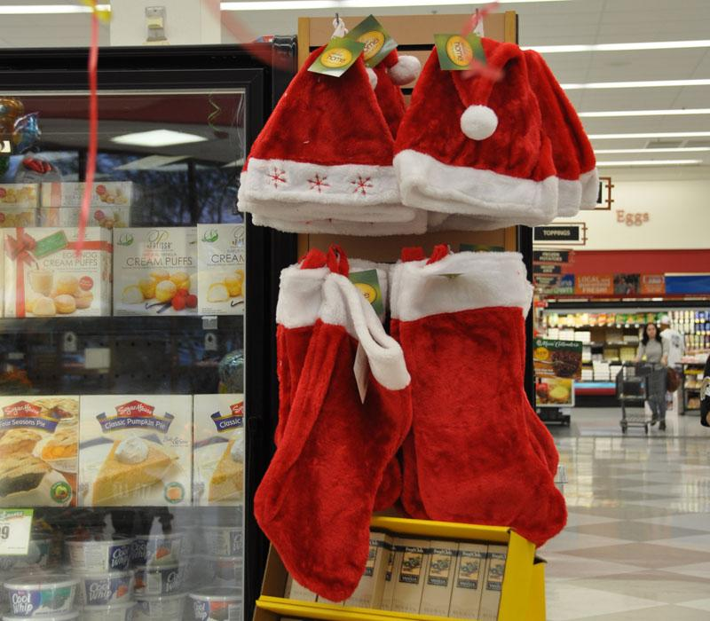 Stockings and Santa hats hang in full view in a near by Bashas grocery store a week before December 1st. These bright beacons are distracting from the spirit of Thanksgiving and the over all month of November.