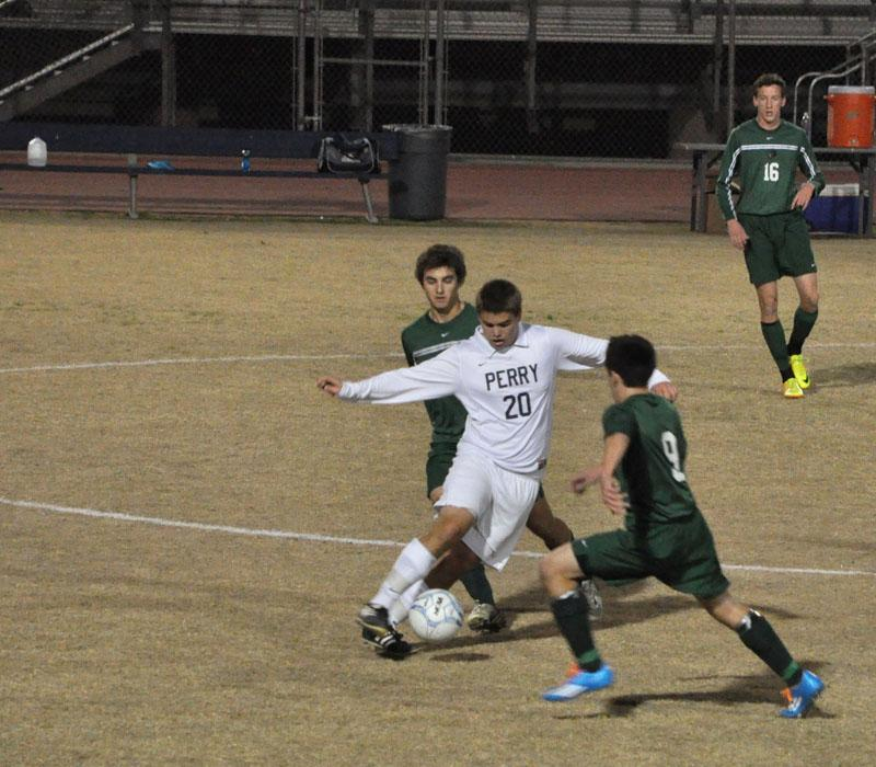 Dee Kater defends the ball against Basha's defense.
