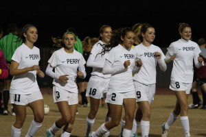 The girls Varsity soccer team get ready to compete at Perry High School and play against Desert Ridge on January 9, 2014.