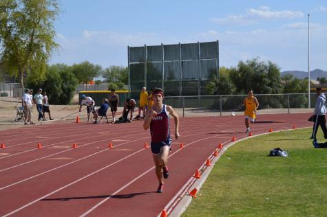 Sophomore, Cade Burks races during a meet against Queen Creek.