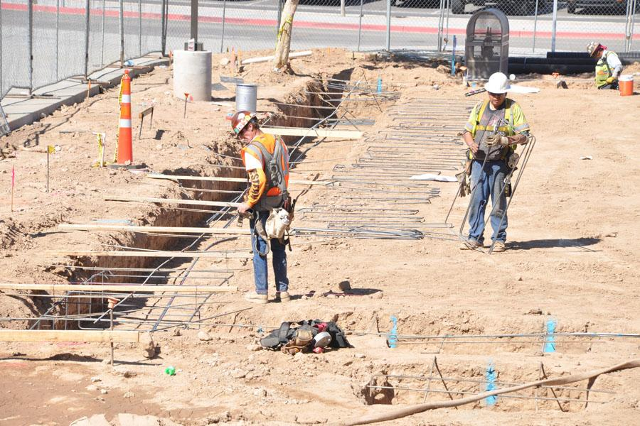 The construction crew works to lay the foundation for the new Career and Technical Education building on the west side of campus. The new building will also house science classes. It was originally set for completion by the beginning of the 2014-2015 school year, but it was pushed back to mid-October.