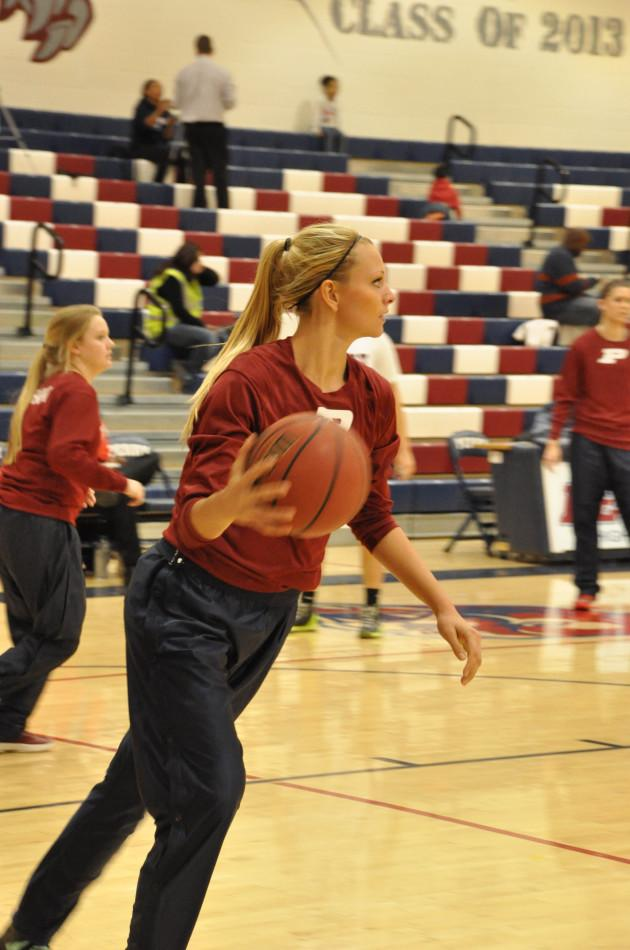 Senior Rachel Amerine warms up before a game.