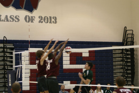 Jalen Cross blocking in a match during the season. Cross was a top blocker in the state and a leader to the rest of the team.