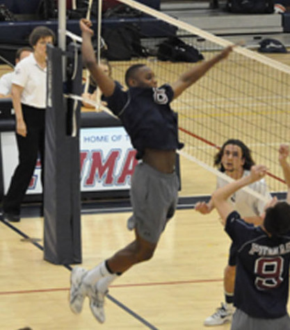 Senior Jalen Cross spikes a ball in a match in late April. Cross, who lead the team in kills with 309, was an intregal part of Perry's team who went 37-8, and solidified itself as a volleyball power. With only four seniors graduating, the Pumas' future looks bright.