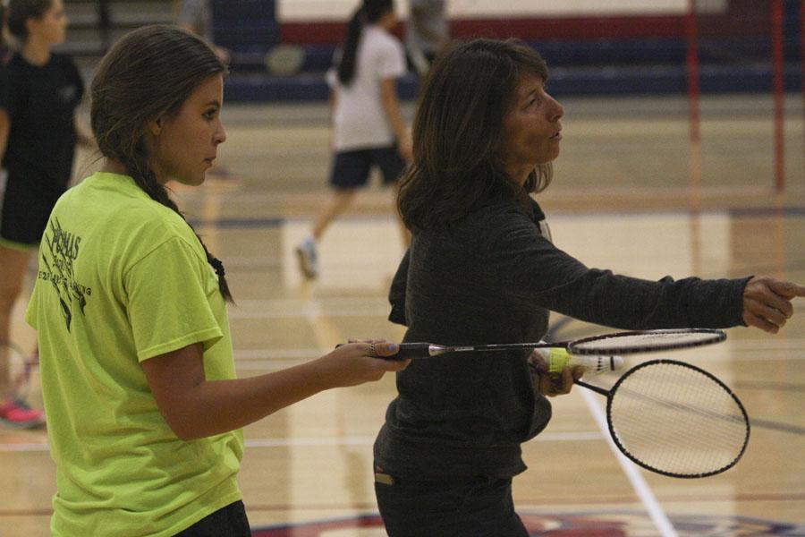 Head coach Lerina Johnson works with Laike Reader during practice last week.