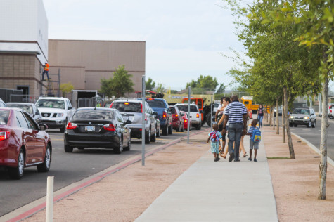 A family walks their children to the daycare as PHS students and parents scramble to make it to class on time.