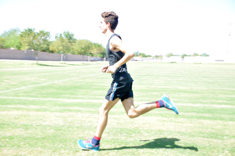 Varsity runner and team captain, Cade Burks, practicing at Perry high school.