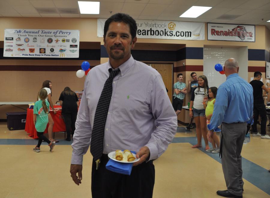 Principal Dan Serrano enjoying food from the event.