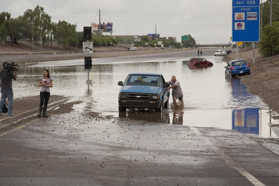 Phoenix man pushes his truck through flooding on the I-10.