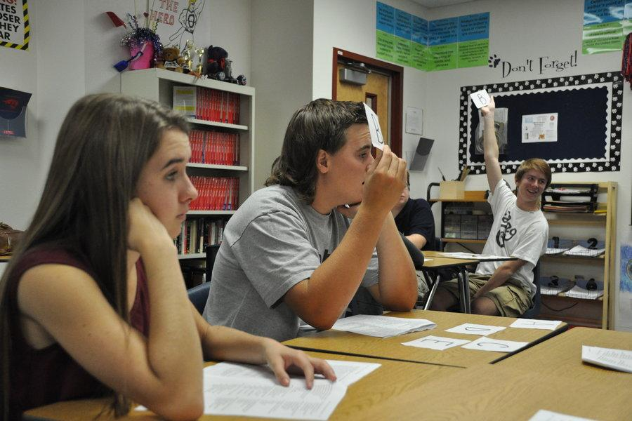 Juniors Sam O'Hare and Ross Hill play an educational game in Cindy Pino's AP English class. Some teachers are finding new  ways to make Common Core curriculum enjoyable.