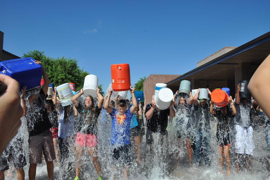 Rob Lange and his DECA class complete the ALS ice bucket challenge at Perry High School.