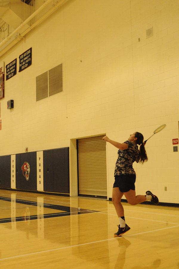 Senior Jenna Reynolds prepares to return a serve.