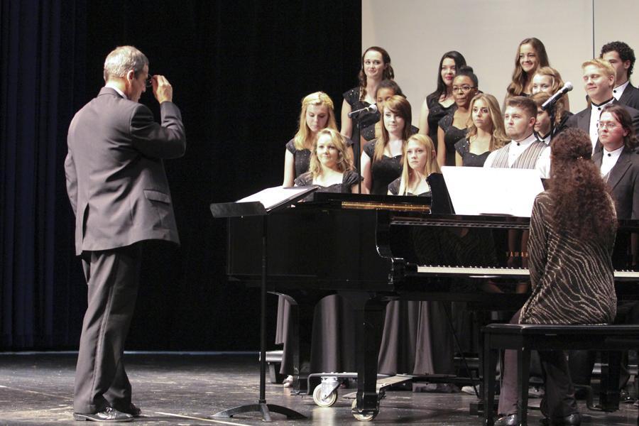 Choir concert prepares their next song at their first concert on September 19.
