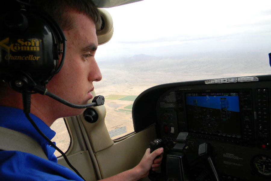 Senior Kevin Logue inside the cockpit mid-flight.
