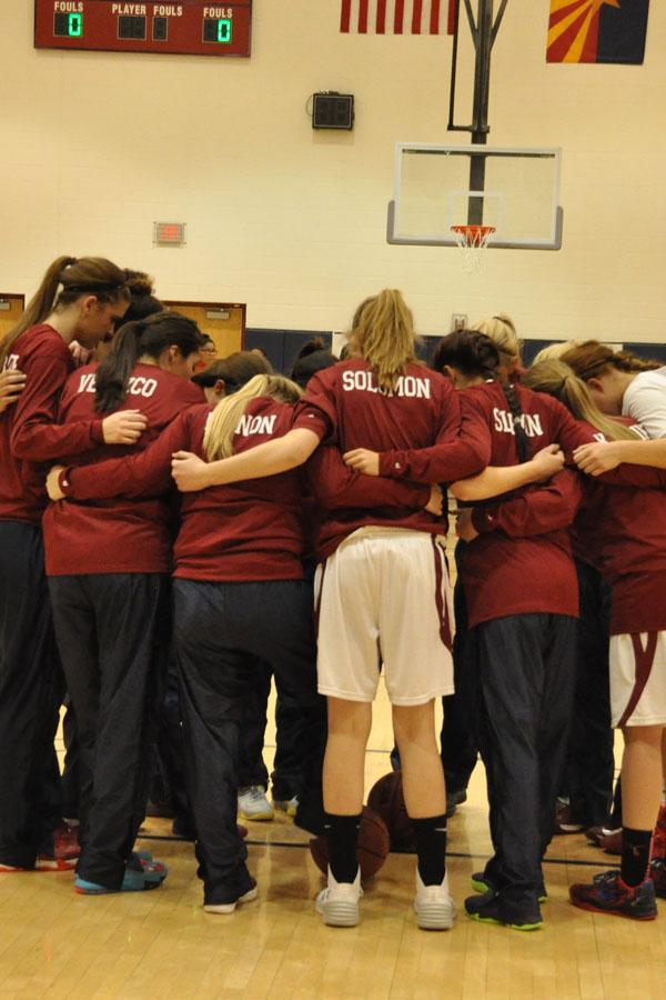 The Lady Pumas huddle together before a game