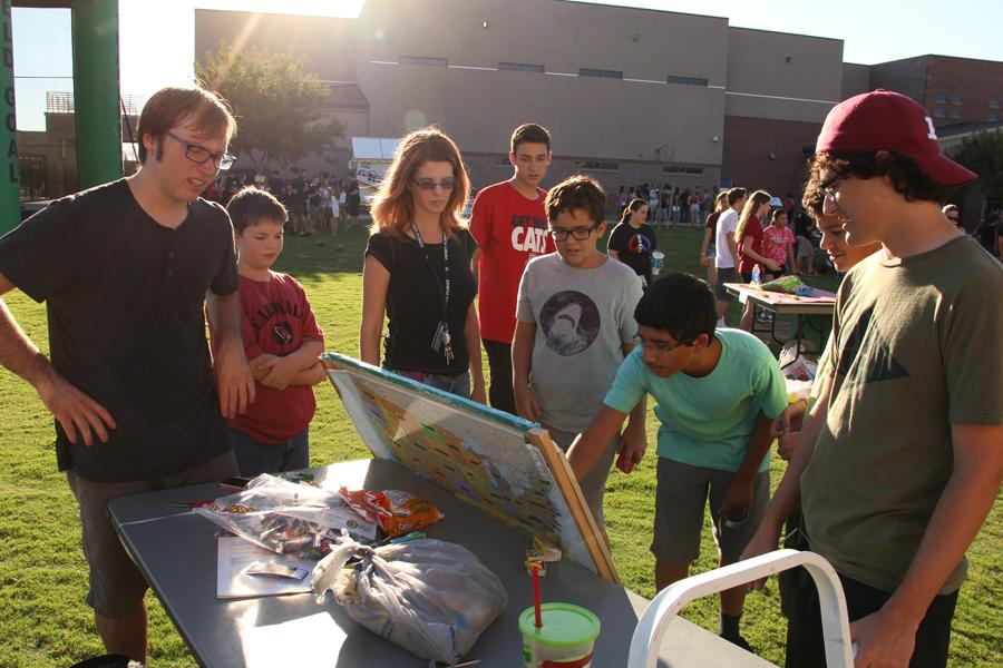 English teacher Janet Larkin (center) and several students participate in games during the Homecoming Carnival earlier this semester. With news of the new 7-12 school opening, some students are concerned if their boundaries will change.