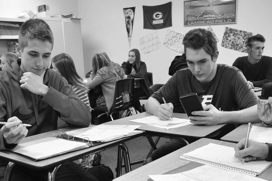 Junior Justin Vredevoogd and sophomore Jaron Barnes work on a project in their honors brief-calculus class last week. With the exception of seniors, all students will take the AzMERIT math, reading and writing tests this spring.