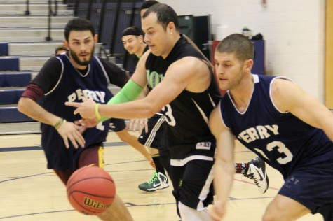 Teachers play basketball to fundraise for the holidays