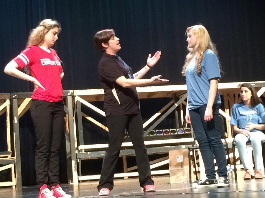 (From left:) 56th Street Comedy Team captain Candace, referee Krissy Lenz, and junior Julia Gilmer all at center stage for a 'Captain Challenge' during the improv show held at Perry on Friday Jan. 23.