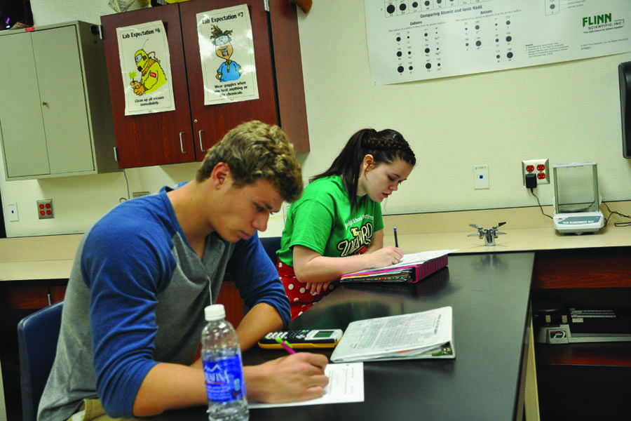 Juniors Brody Vossler and Kelly Crawley work in Chemistry. The removal of Common Core will affect the way students learn in the classroom, and will allow them to learn at their own pace.