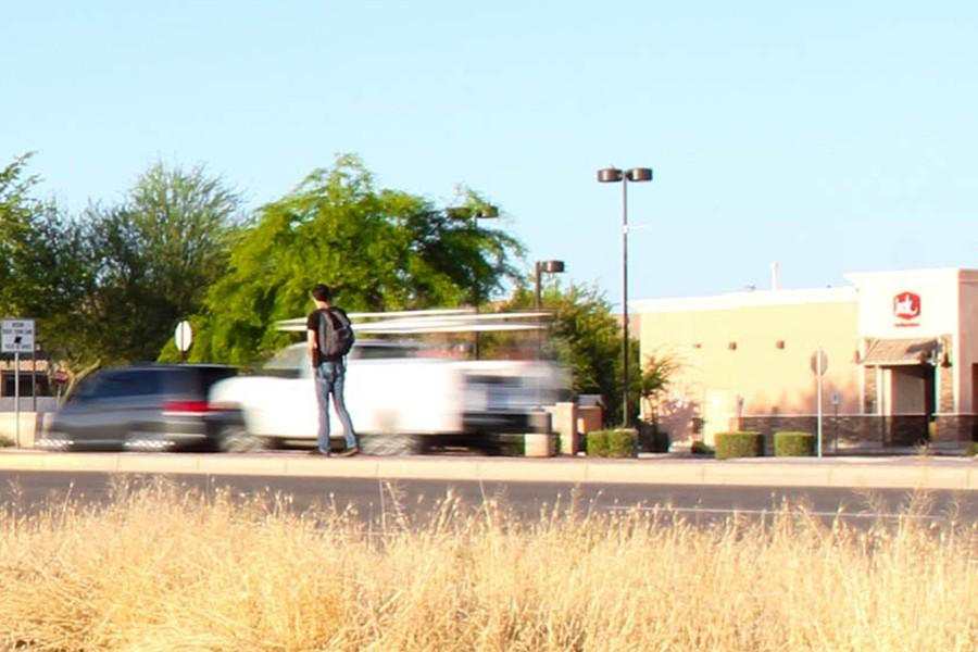 Students risk crossing Val Vista Drive during the heart of morning rush hour in order to park off campus.