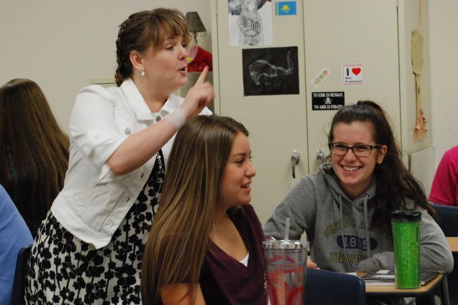 Duering teaches AP English 12 and Humanities. Next year, she will be department head for Casteel High School.