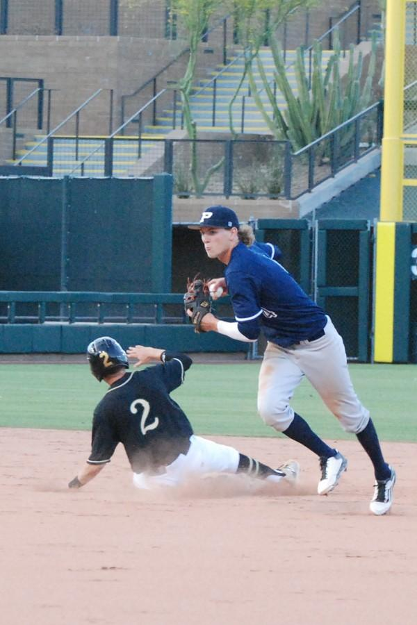 Senior shortstop Jeremy McCuin turns a double play against Basha on April 23. The Pumas beat the Bears at Salt River Field, 5-0 and earned a No. 7 seed in the division-I playoffs.