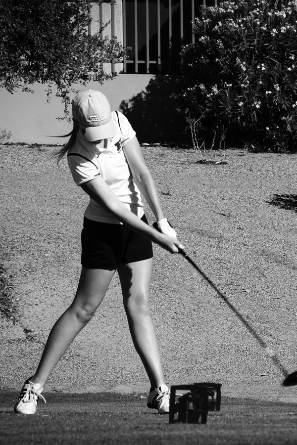 Junior Kati Gloss drives on Foothills Golf Course during their match against Desert Vista.