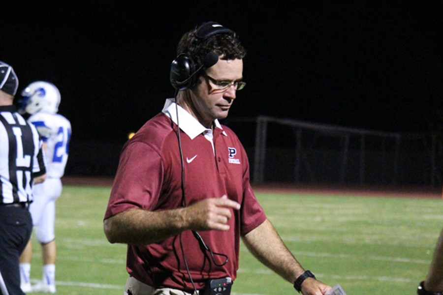 Perry head coach Preston Jones walks the sidelines during the Pumas' home opener against Dobson last week. For the first time in his career, Jones will coach against his father - Jim - when PHS hosts Mesquite in week 2.