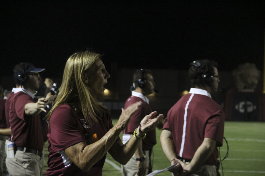 Coach Boone cheers on the Perry varsity football team at their first game of the 2015 season on august 21st, 2015. Photo by: Lauren Haught