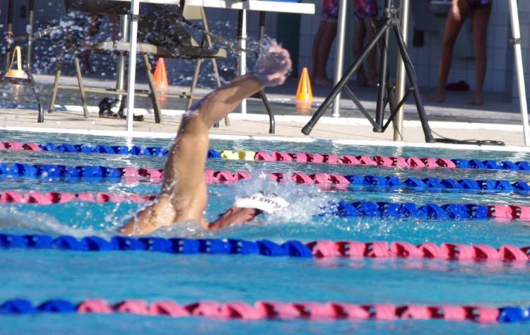 Senior Jake Perrine swims to the finish line