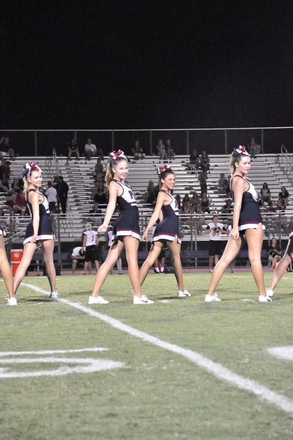 Varsity cheer performing during the homecoming football game