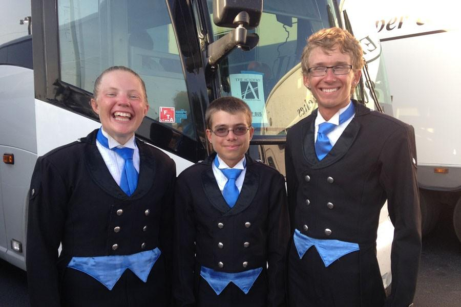 Senior Cari Earnhardt (left), junior Evan LaBate (center), and Perry alumni Matt Warren (left) pose in front of their tour bus before a performance. The Academy traveled all over the country  to perform this summer.