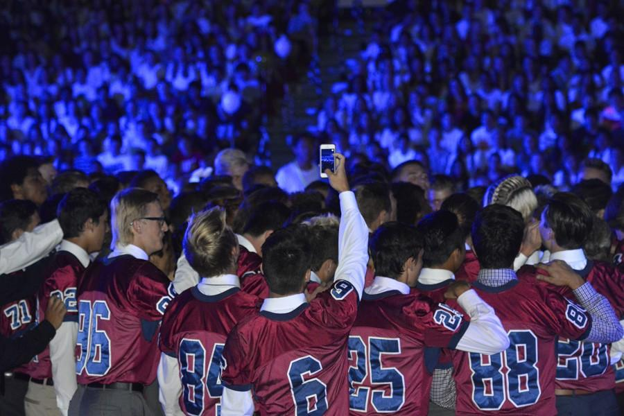 Perry Varsity Football team comes out during the Homecoming Assembly, Friday September 18 in the main gym.