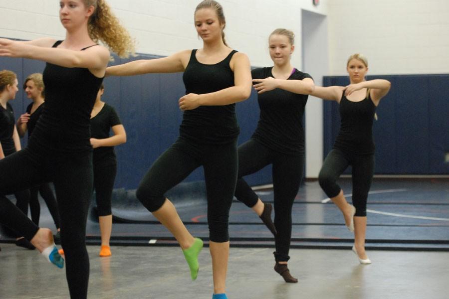Beginning dancers practicing proper ballet technique
