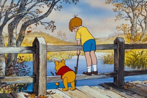 Winnie the Pooh (voiced by Sterling Holloway) and Christopher Robin play a game of