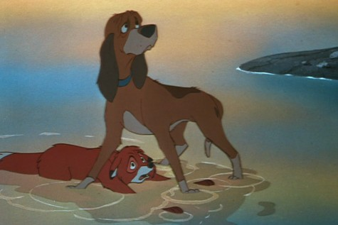 Hound dog Copper protects his one-time childhood friend Tod from the aim of his owner in the film's climatic scene (Disney).