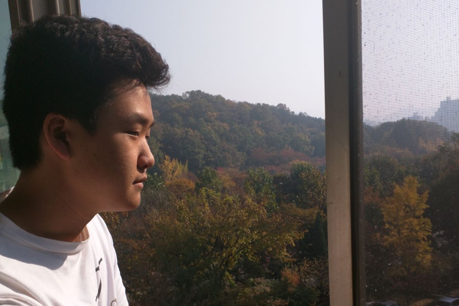 Shin+observes+the+view+from+his+grandparent%27s+house+in+South+Korea.+Shin+has+been+in+Korea+since+the+beginning+of+fall+break%2C+and+was+unable+to+return+home+due+to+problems+with+his+travel+documents.+He+is+expected+to+return+home+at+the+start+of+the+second+semester.